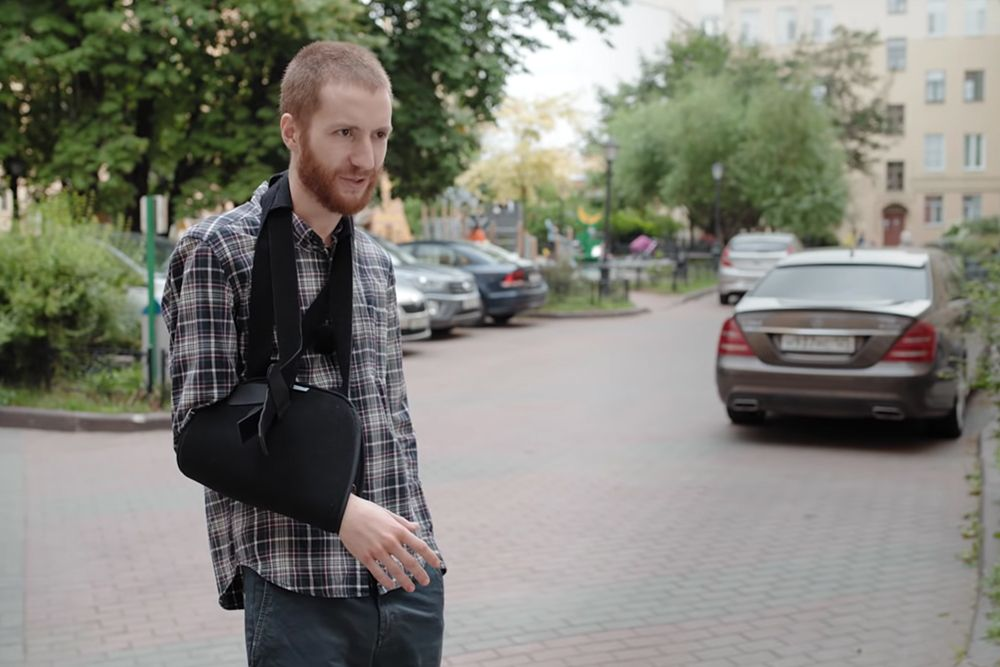 Russian journalist fined for 'disobeying' policeman who broke his arm